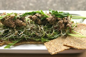Sunflower Walnut Pate on flax crackers with sprouts and arugula
